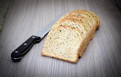 Fresh Tasty Bread on Woody Background - stock photo
