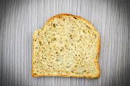 Stock Photo of Fresh Tasty Bread on Woody Background