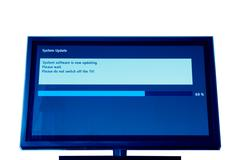 Modern televison update process Stock Photos