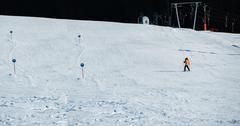 Man skiing down an open slope Stock Photos