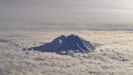 Stock Video Footage of Mt. Rainier poking through the clouds - aerial