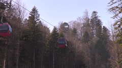Gondola lift, cable car above the mountain forests, early spring, time lapse Stock Footage