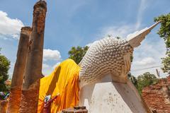 personnel working put yellow robe of buddhist - stock photo