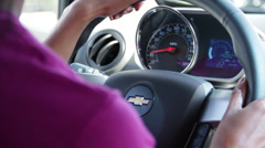 Black girl control the steering and Speedometer shows the speed Stock Footage