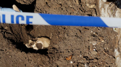 Uncovering skull at crime scene, tracking shot Stock Footage