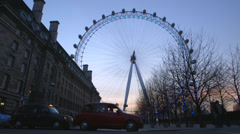 Low angle of London Cabs (Taxi) in front of Millennium Wheel - London, UK Stock Footage