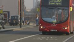 London Red Bus crossing Waterloo Bridge - London, UK Stock Footage