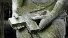 Close-up of hands holding a moldy cross stone sculptures Stock Footage
