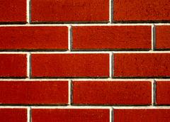 Wall from red bricks - stock photo