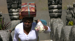 Balinese woman carrying offering at Lempuyang temple Stock Footage