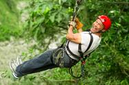 Stock Photo of man zip line