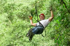 Stock Photo of Adult Man On Zip Line Ecuadorian Andes