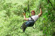 Stock Photo of Adult Man On Zip Line Ecuadorian Andes
