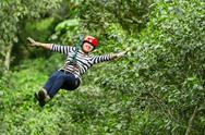 Stock Photo of woman on zip line