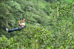 Adult Man On Zip Line Ecuadorian Andes High Altitude Stock Photos