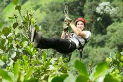 Stock Photo of Adult Man On Zip Line Andes Rain Forest In Ecuador