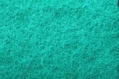Green abrasive sponge texture background Stock Photos