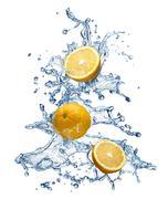 orange fruit and water splash - stock photo