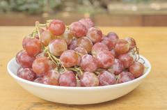 Red grape in ceramic bold Stock Photos