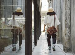 Fashion girl with leather bag at alleyway Stock Photos