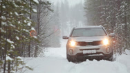 Stock Video Footage of Vehicle is slipping in snow at winter season. Deep forest and no one to help