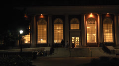 Exterior night college library and students Stock Footage