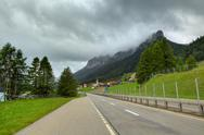 Stock Photo of highway among hills and mountains in switzerland.
