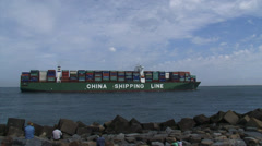 Large container ship China Shipping Line Saturn entering Port of Rotterdam Stock Footage