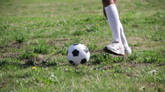 On a green ground, girl practise with the soccer ball Stock Footage