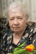 senior woman portrait of a 88 year old lady - stock photo