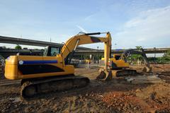 Excavator and backhoe Stock Photos