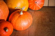 Stock Photo of pumpkins on grunge wooden backdrop background