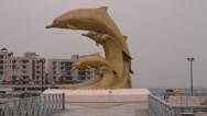 Stock Video Footage of A close shot of the dolphin statue at Hong Kong Gold Coast