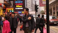 A tilt shot daytime scene in causeway bay hong kong Stock Footage