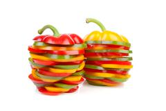 Two paprika made out of colorful slices Stock Photos