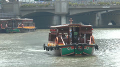 A bumboat cruising on Singapore River near Coleman Bridge.(SG RIVER--109b) - stock footage