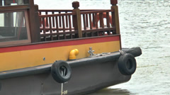 A tourist bumboat berthing at Singapore River. (SG RIVER--108b) Stock Footage