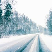 Snowy land road Stock Photos