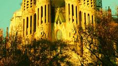 Cathedral Sagrada Familia famous church and landmark in BARCELONA, SPAIN, tilt Stock Footage