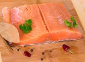 Stock Photo of Trout fillet on wooden background