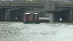 A bumboat cruising under Coleman Bridge, Singapore River - stock footage