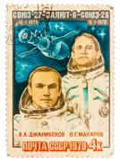Stamp printed by russia, shows djanibekov and makarov, spacecraft Stock Photos