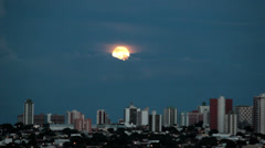 Stock Video Footage of Real Scene - Big moon rising behind the clouds.
