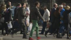Commuters and tourists crossing a busy street Stock Footage