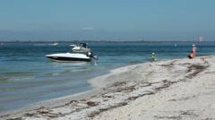 Family beach fun boating Sanibel Island Florida HD 2153 Stock Footage