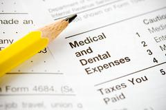 Taxes: focus on medical and dental section of 1040 Stock Photos