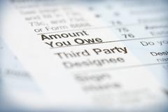 Taxes: focus on amount you owe section of 1040 tax form Stock Photos
