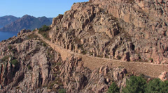 Aerial corsica piana mountains road corse Stock Footage
