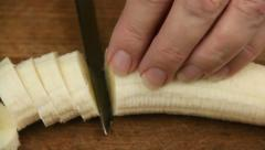 Slicing Banana Into Slices Stock Footage