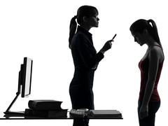 Teacher woman mother teenager girl reproach discussion  in silhouette uette Stock Photos